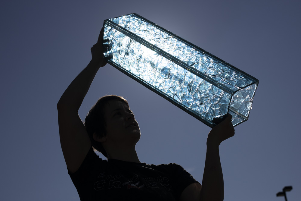 Artist Builds Sculpture from Early 20th Century Glass from NC Textile Mills